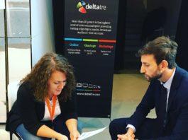 Immagine che rappresenta un colloquio di lavoro, con due persone sedute a un tavolino